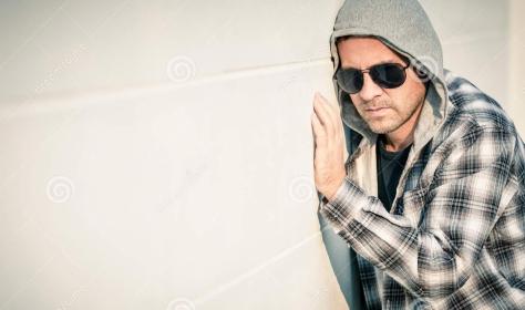 portrait-sad-man-sunglasses-sitting-near-house-one-outdoors-day-time-50114504